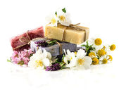 Soap bars with lavender, jasmine and chamomile flowers — Stock Photo