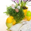 Easter table setting with flowers, eggs and candles - Stock Photo