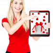 Young happy woman with tablet PC gift card — Stock Photo