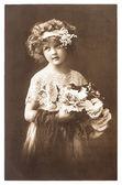 Vintage nostalgic portrait of little girl — Stock Photo