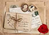Old french post cards and rose flower — Stock Photo