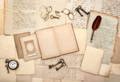 Open book, old letters, post cards, glasses, keys, clock — Stock Photo