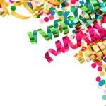 Colorful confetti with multicolored streamer — Stock Photo #21840179