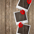 Vintage photo frames with red rose petals — Stok fotoğraf