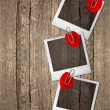 Stock Photo: Vintage photo frames with red rose petals