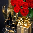 Red roses, golden gift and and champagne - 