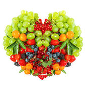 Heart shaped mix of fruits and berries on white — Stock Photo