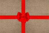 Rote Schleife-Bogen auf Karton Papier Textur — Stockfoto