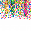 Colorful confetti and shiny streamer — Stock Photo