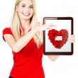 Young happy woman show a Valentine's Day gift card — Stock Photo