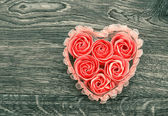 Bath soap with rose petals on wooden background — Stock Photo