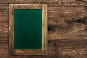 Vintage green blackboard with rustic frame — Stock Photo