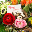 Easter arrangement with eggs decoration and greeting card — Stock Photo