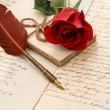 Red rose flower, old letters and antique feather pen — Stock Photo #21903431