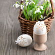 Stock Photo: Easter decoration with eggs and snowdrops