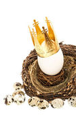 White easter egg with golden crown decoration — Stock Photo