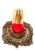 Red easter egg with golden crown decoration — Stock Photo