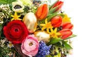 Closeup of colorful easter bouquet with golden eggs — Stock Photo