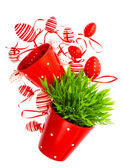 Red white painted easter eggs with green grass — Stock Photo