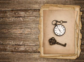 Old paper sheet over rustic wooden background — Stok fotoğraf