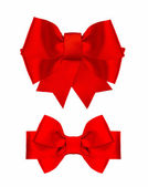 Red silk ribbon bow isolated on white — Stock Photo