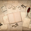 Open book, vintage antique accessories and old letters — Stock Photo #21911805
