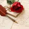Old letters, rose flower and antique feather pen - Stockfoto