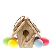 Easter decoration with birdhouse and colorful eggs — Stock Photo
