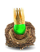 Green easter egg with golden crown decoration — Stock Photo