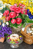 Easter cake and eggs with beautiful spring flowers — Stock Photo