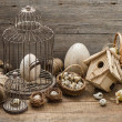 Vintage easter decoration with eggs and birdcage — Stock Photo #22519105