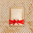 Vintage card on grunge polka dot background — Stock Photo