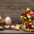 Vintage easter decoration with eggs and tulips — Stock Photo #22529367