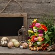 Vintage easter decoration with eggs and tulip flowers - Stock Photo
