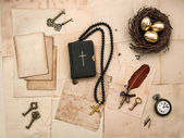 Bible book, easter, eggs, golden cross, old papers and pictures — Stock Photo
