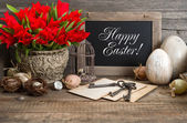 Vintage easter decoration with eggs and red tulip flowers — Stock Photo