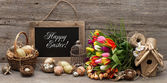Vintage easter decoration with eggs and tulip flowers — Stok fotoğraf