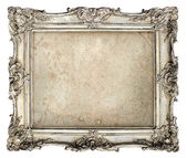 Old silver frame with empty grunge canvas — Stockfoto
