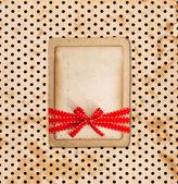 Vintage card on grunge polka dot background — Stock Photo
