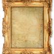 Old golden frame with empty grunge canvas - Stock Photo