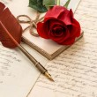 Red rose flower, old letters and antique feather pen — Stock Photo