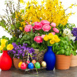 Colorful composition with spring flowers and easter eggs — Stock Photo