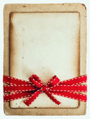 Vintage card with red ribbon bow isolated on white — Stock Photo