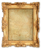 Old golden frame with empty grunge canvas — 图库照片