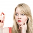 Young blond girl afraid with medicine pill — Stock Photo #22686715