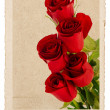 Bouquet of red roses in vintage postcard style — Stock Photo