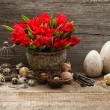 Vintage easter decoration with eggs and red tulips — Stock Photo