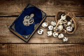 Decoration with eggs and antique bible book — Stock Photo