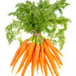 Fresh carrots with green leaves isolated on white — Stock Photo #24432569
