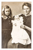 Antique portrait of mother with children — Stock Photo